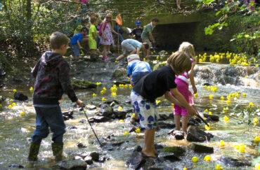 Children enjoy the annual Great Sheffield Duck Race in Endcliffe Park, Sheffield.